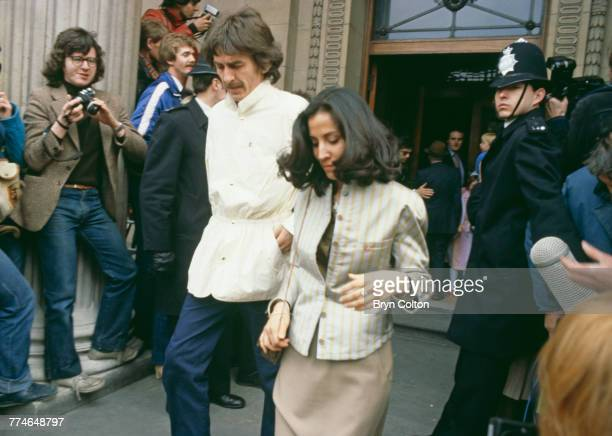 Former Beatle George Harrison and his wife Olivia Harrison leaving Marylebone Register Office after the wedding ceremony of fellow Beatle Ringo Starr...