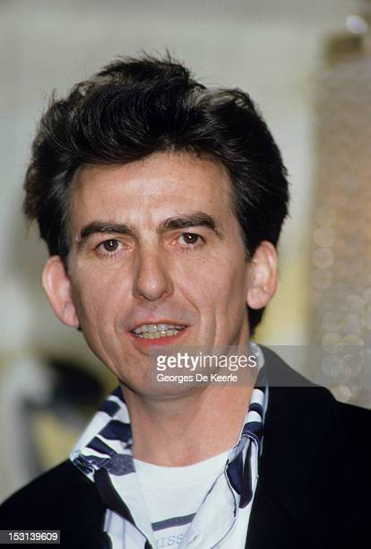 Former Beatle George Harrison holds a press Conference with Madonna for their film 'Shanghai Surprise' at the Kensington Roof Gardens in London on...