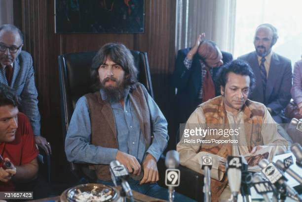 Former Beatle George Harrison pictured centre with Ravi Shankar on right and Allen Klein on left as they attend a press conference to promote their...