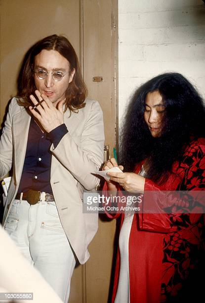 Former Beatle John Lennon and a pregnant Yoko Ono attend a performance of the Broadway play 'Same Time Next Year' at the Brooks Atkinson Theatre in...