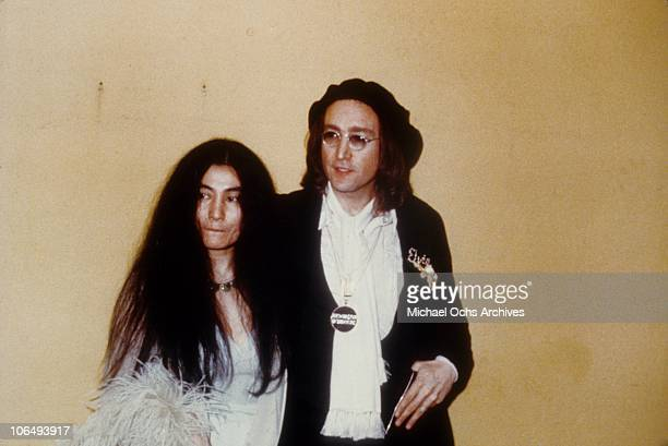 Former Beatle John Lennon and a pregnant Yoko Ono attend the 17th Annual Grammy Awards on March 1 1975 at the Uris Theater in New York City New York