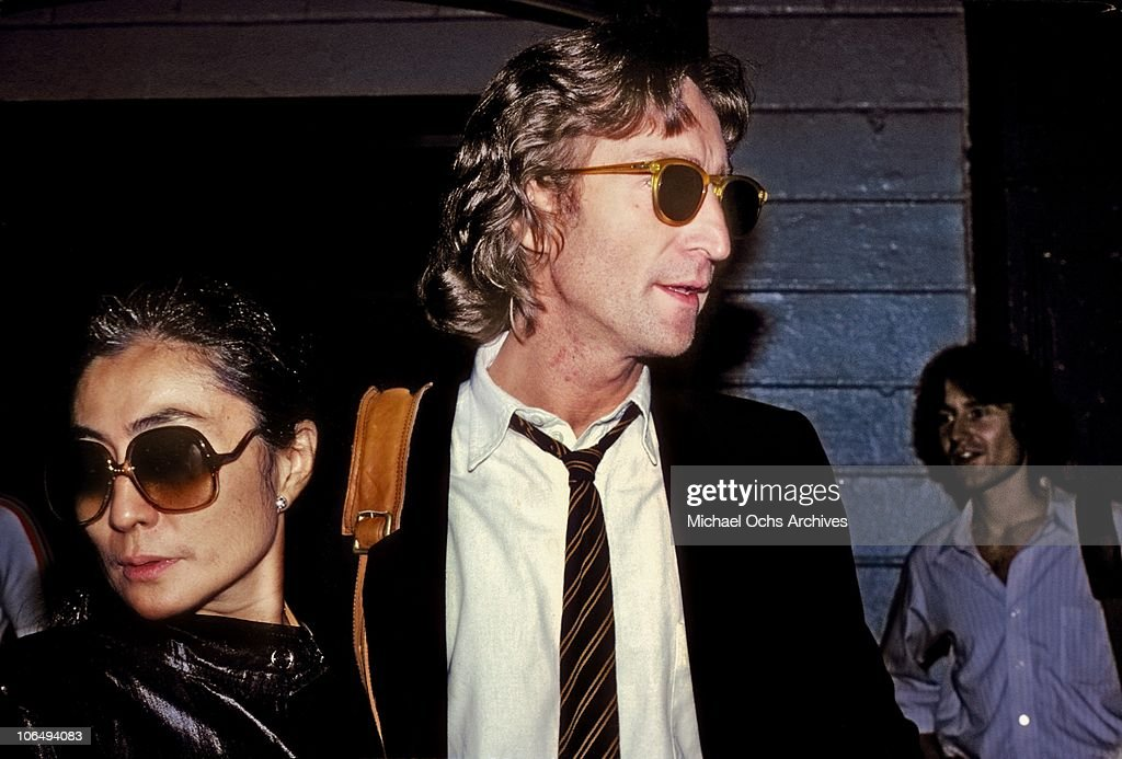 Former Beatle John Lennon and his wife Yoko Ono outside of the Times Square recording studio 'The Hit Factory' before a recording session of his final album 'Double Fanasy' in August 1980 in New York City, New York.