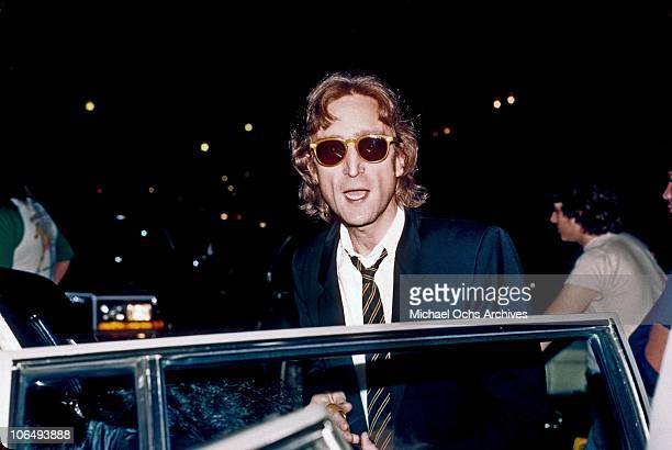 Former Beatle John Lennon arrives at the Times Square recording studio 'The Hit Factory' before a recording session of his final album 'Double...