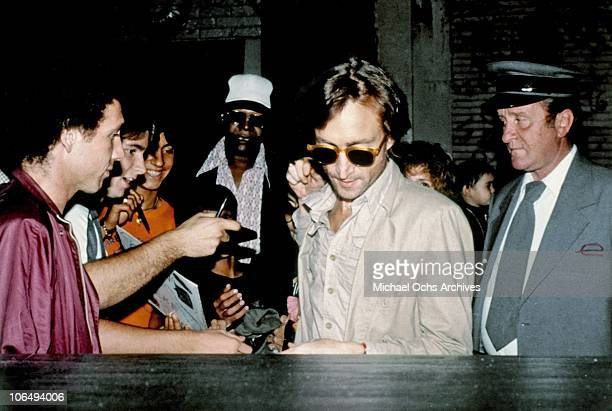 Former Beatle John Lennon leaves the Times Square recording studio 'The Hit Factory' after a recording session of his final album 'Double Fanasy' in...