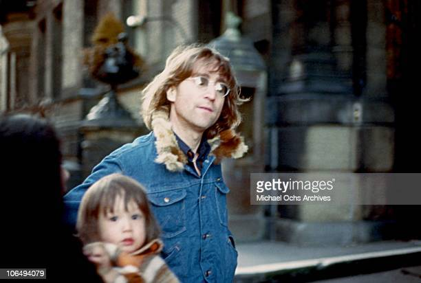 Former Beatle John Lennon poses for a photo with his wife Yoko Ono and son Sean Lennon New York City 1977