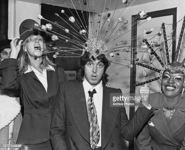 Former Beatle Paul McCartney and his wife Linda try on some of the headdresses from the offBroadway stage show 'Sgt Pepper's Lonely Hearts Club Band...