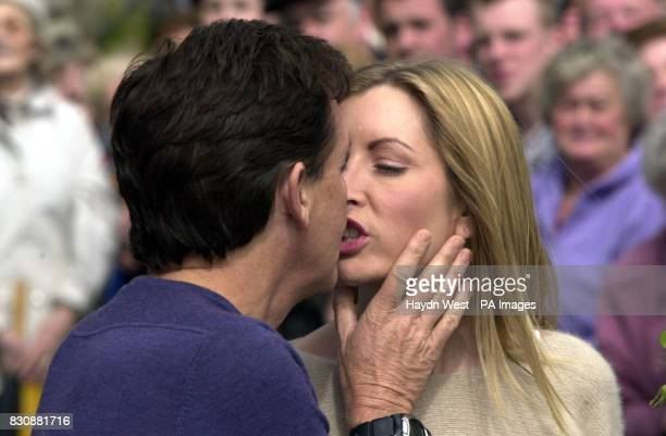 Former Beatle Sir Paul McCartney kisses his bride Heather Mills as they pose for photographers outside Castle Leslie in Glaslough County Monaghan...