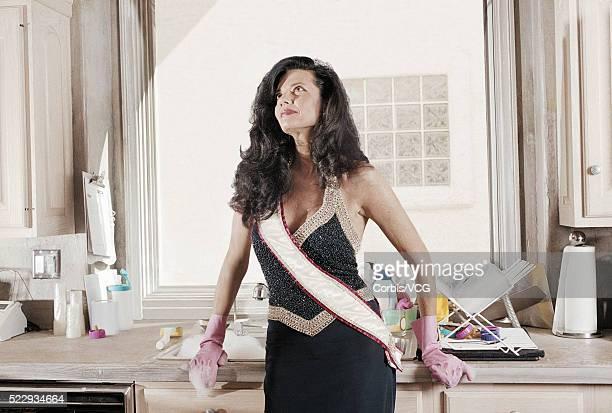 Former Beauty Queen Standing in Kitchen