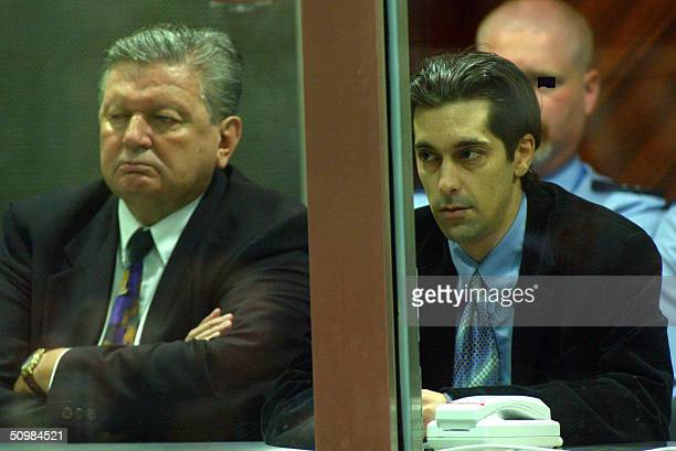 Former Belgian businessman Michel Nihoul and codefendant Michel Lelievre sit in dock of the courthouse in the southeastern Belgian town of Arlon...