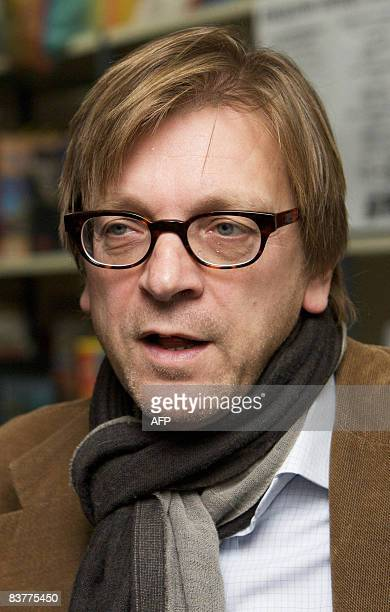 Former Belgian Prime Minister Guy Verhofstadt reads a story for children at the library Brugse Poort in Gent during the Reading breakfast of the Read...