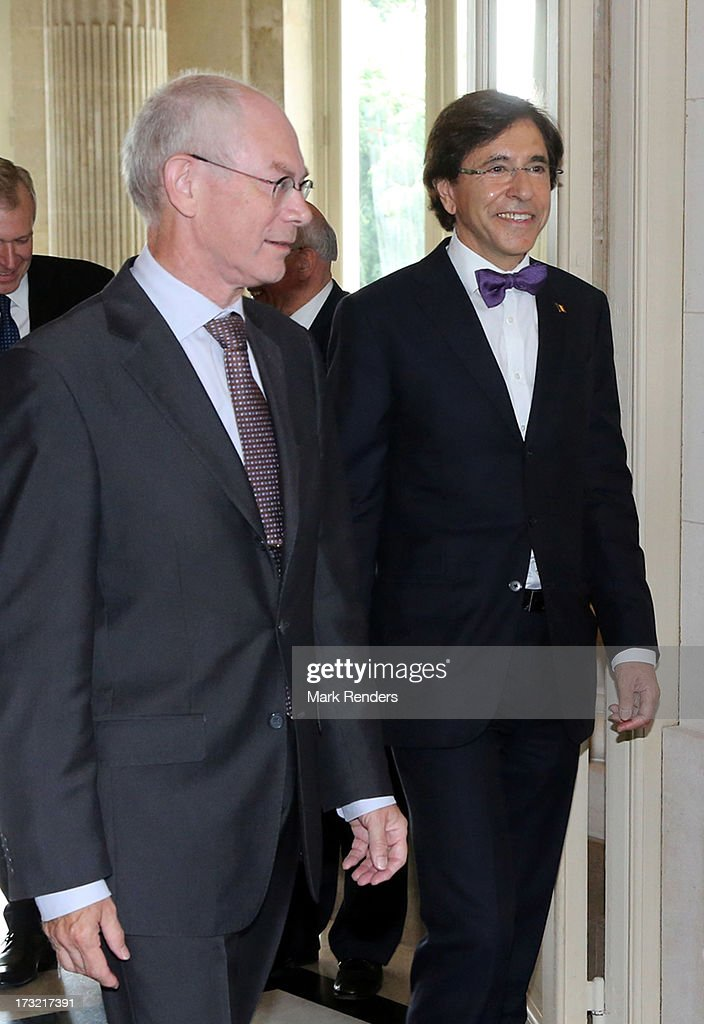 Former Belgian Prime Minister Herman Van Rompuy (L) and Belgian Prime Minister Elio Di Rupo attend Laeken Castle on July 10, 2013 in Brussels, Belgium.