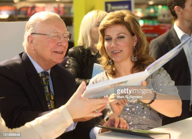 Former Belgian Prime Minister Marc Eyskens and Princess Martha Louise of Norway exchange each other's books at the Antwerp Book Fair on November 6...