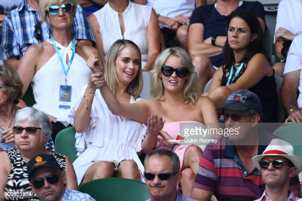 Former Big Brother contestant Tully Smyth watches the semifinal match between Caroline Wozniacki of Denmark and Elise Mertens of Belgium on day 11 of...
