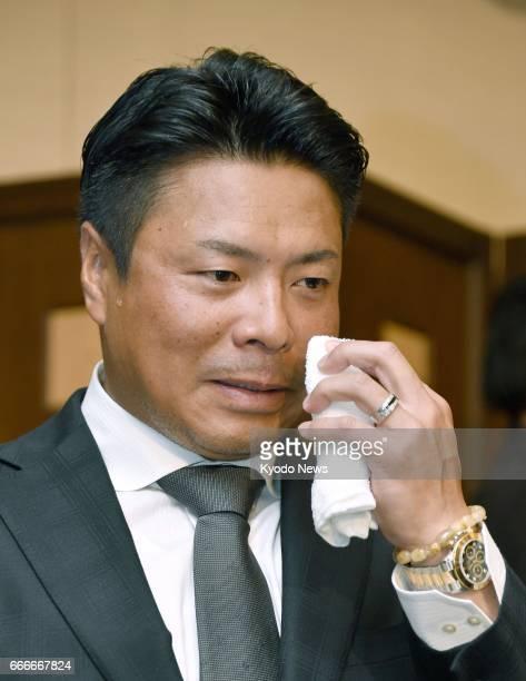 Former big leaguer Akinori Iwamura attends a press conference in Tokyo on April 10 announcing that he will retire at the end of the current season...