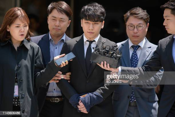 TOPSHOT Former BIGBANG boyband member Seungri real name Lee Seunghyun is taken into custody as he leaves the High Court in Seoul on May 14 2019 The...