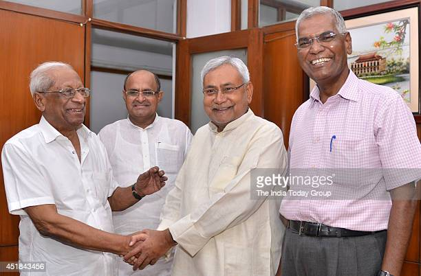 Former Bihar Chief Minister and senior Janta Dal party leader Nitish Kumar and K C Tyagi shakes hand with Communist Party of India leaders A B...