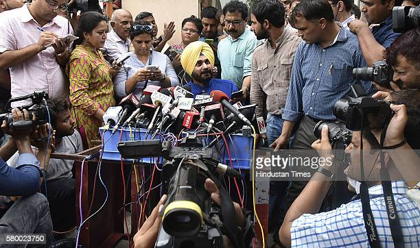 Former BJP leader Navjot Singh Sidhu attends a press conference for the first time after he resigned from the Upper House at his CWG residence Khel...