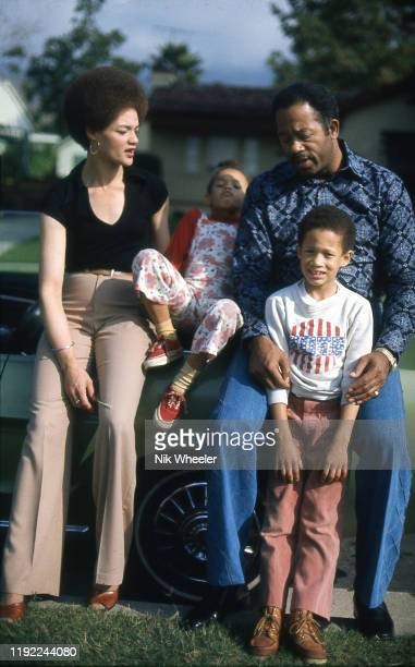 Former Black Panther Information Minister Eldridge Cleaver with his wife kathleen Cleaver and children Ahmad and Juji outside their home in Altadena...