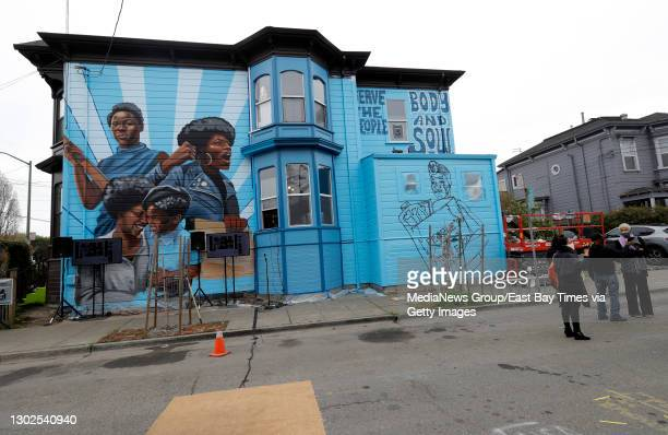 Former Black Panther Party member Ericka Huggins, far right, and others, attend the unveiling of the mural by Rachel Wolfe-Goldsmith on Jilchristina...