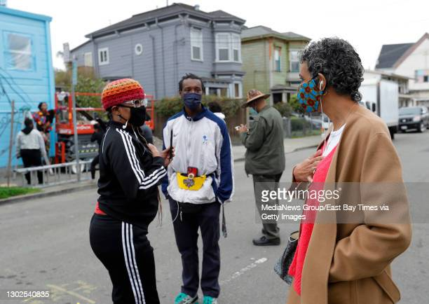 Former Black Panther Party member Fredrika Newton, widow of Panther Huey Newton, right, speaks with Traci Bartlove, left, the unveiling of the mural...