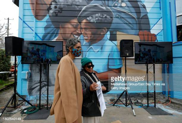 Former Black Panther Party members Fredrika Newton, widow of Panther Huey Newton, left, and Kim Nelson, attend the unveiling of the mural by Rachel...