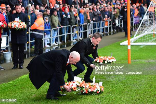 Former Blackpool player Derek Spence lays a wreath in front of the Armfield stand during the Sky Bet League One match between Blackpool and Charlton...