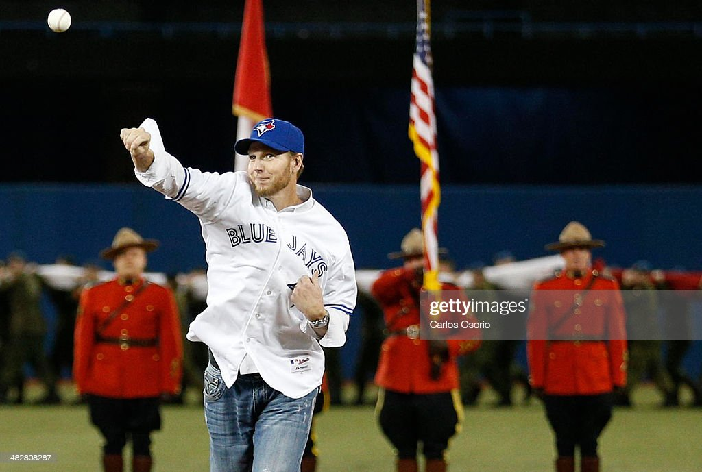 TORONTO, ON - APRIL 4 - Former Blue Jay Roy Halladay throws out the ceremonial first pitch as the Toronto Blue Jays take on the New York Yankees at the Rogers Centre on April 4, 2014. This is Toronto's first home game of the season.