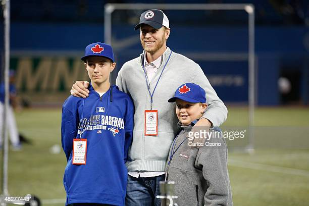 TORONTO ON APRIL 4 Former Blue Jays pitcher Roy Halladay poses for a photograph with his sons Braden and Ryan during Blue Jays batting practice at...