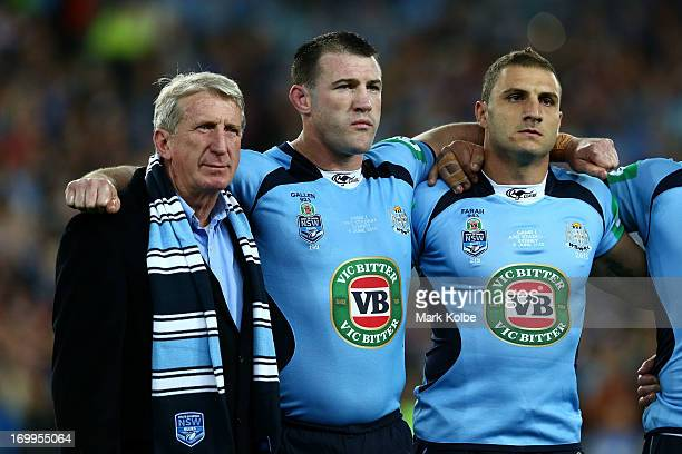 Former Blues player Steve Mortimer Paul Gallen and Robbie Farah of the Blues sing the national anthem before game one of the ARL State of Origin...