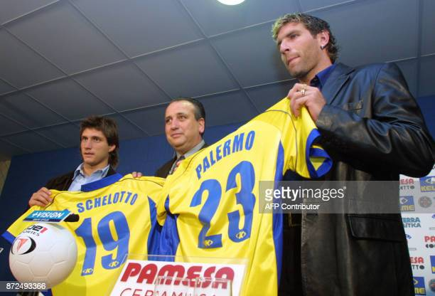 Former Boca Juniors' players Martin Palermo and Gustavo Barros Schelotto hold their new jerseys while being presented to the media by the President...