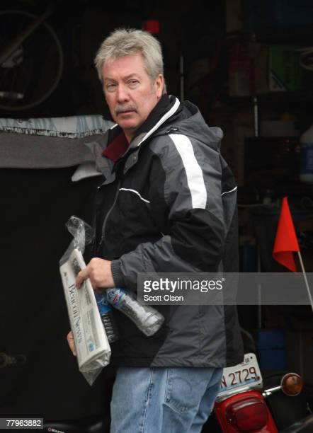 Former Bolingbrook Illinois police Sgt Drew Peterson stands in front of the garage at his home November 17 2007 in Bolingbrook Illinois Peterson is a...
