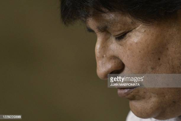 Former Bolivian President Evo Morales gestures during a press conference in Buenos Aires, on October 22 amid the coronavirus pandemic. -...
