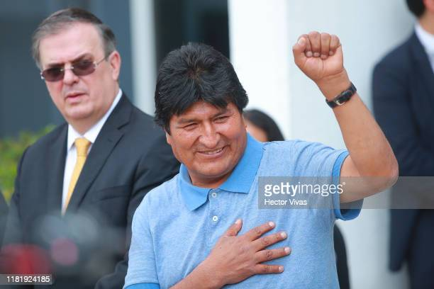 Former Bolivian president Evo Morales greets the press as he arrives to Benito Juarez International Airport after accepting the political Asylum...