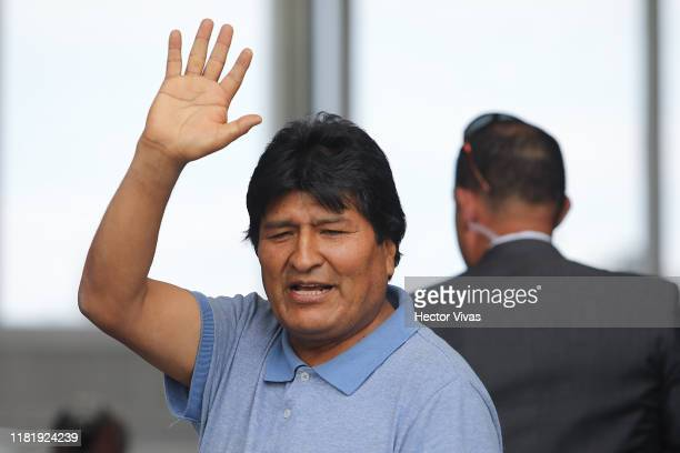 Former Bolivian president Evo Morales waves to the press on his arrival to Benito Juarez International Airport after accepting the political Asylum...