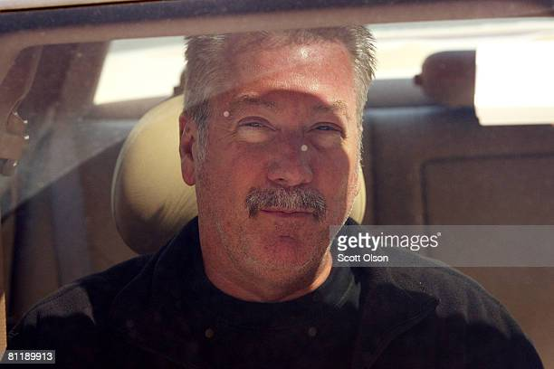 Former Bolllingbrook Illinois police officer Drew Peterson leaves the Will County Jail in his attorney's car after posting bail for a felony weapons...