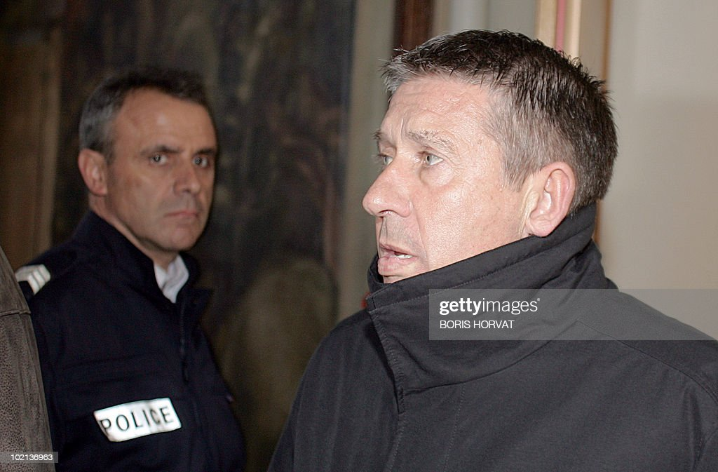 Former Bordeaux sporting director Charles Camporo leaves the Marseille court, 14 March 2006, after the second day of the trial of corrupt transfer dealings between 1997 and 1999 in the football club of Marseille, which meant 15 million euros acquired illegally. He stands trial with former manager of the French first league club OM, Rolland Courbis and the club's major shareholder, Robert Louis-Dreyfus.