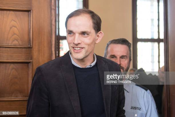 Former Borussia Dortmund head coach Thomas Tuchel leaves after a hearing as a witness in the trial on a bomb attack on the team bus of German first...