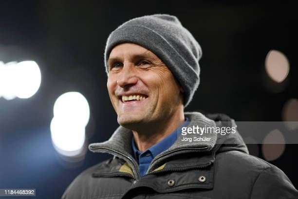 Former Borussia Moenchengladbach player Heiko Herrlich looks on prior to the DFB Cup second round match between Borussia Dortmund and Borussia...