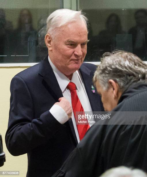 Former Bosnian military chief Ratko Mladic gestures before appearing for the pronouncement of the Trial Judgement for the International Criminal...