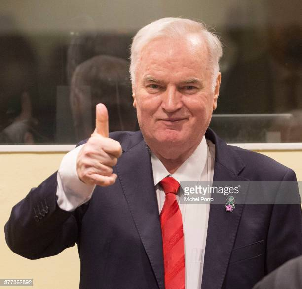 Former Bosnian military chief Ratko Mladic gives a thumbs up as he appears for the pronouncement of the Trial Judgement for the International...