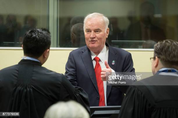 Former Bosnian military chief Ratko Mladic meets his lawyers as he appears for the pronouncement of the Trial Judgement for the International...