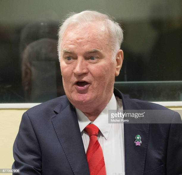 Former Bosnian military chief Ratko Mladic speaks to his lawyers before appearing for the pronouncement of the Trial Judgement for the International...