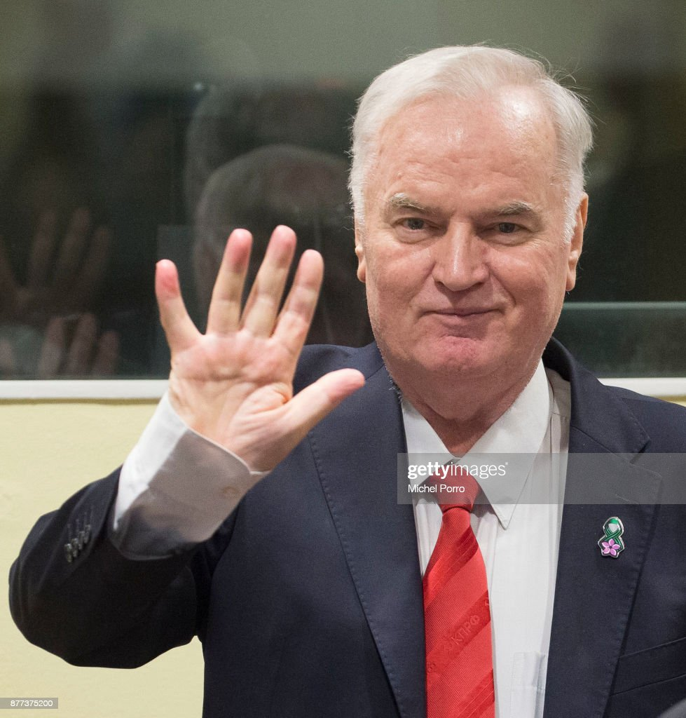 Former Bosnian military chief Ratko Mladic waves as he appears for the pronouncement of the Trial Judgement for the International Criminal Tribunal for the former Yugoslavia (ICTY) on November 22, 2017 in The Hague, The Netherlands. UN war crimes judges at The Hague are expected to deliver a verdict on Bosnian Serb military commander Ratko Mladic, dubbed the 'Butcher of Bosnia' today. Mladic, 74, is accused of 11 counts - which include genocide, war crimes and crimes against humanity committed by his forces during the war in Bosnia from 1992 and 1995.