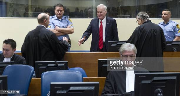 Former Bosnian Serb commander Ratko Mladic enters the International Criminal Tribunal for the former Yugoslavia on November 22 to hear the verdict in...