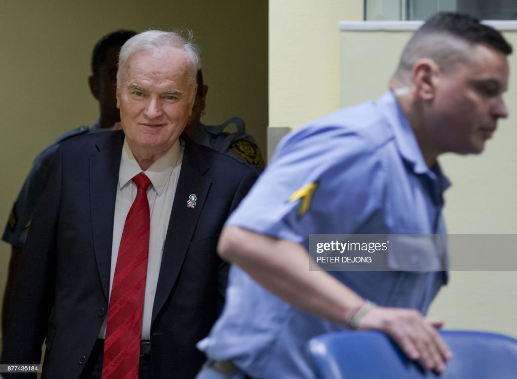Former Bosnian Serb commander Ratko Mladic (L) enters the International Criminal Tribunal for the former Yugoslavia (ICTY), on November 22, 2017, to hear the verdict in his genocide trial. Ratko Mladic, who was convicted of genocide on November 22, 2017, believed himself to be a crusading defender of the Serbs but was dubbed the 'Butcher of Bosnia' for mass slaughter at the hands of his forces. PHOTO / POOL / Peter Dejong