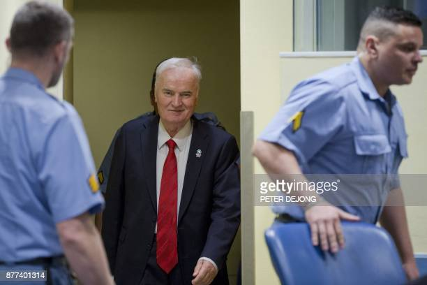 TOPSHOT Former Bosnian Serb commander Ratko Mladic smiles as he enters the International Criminal Tribunal for the former Yugoslavia on November 22...