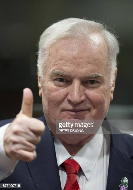 Former Bosnian Serb commander Ratko Mladic thumbs up as he enters the International Criminal Tribunal for the former Yugoslavia on November 22 to...