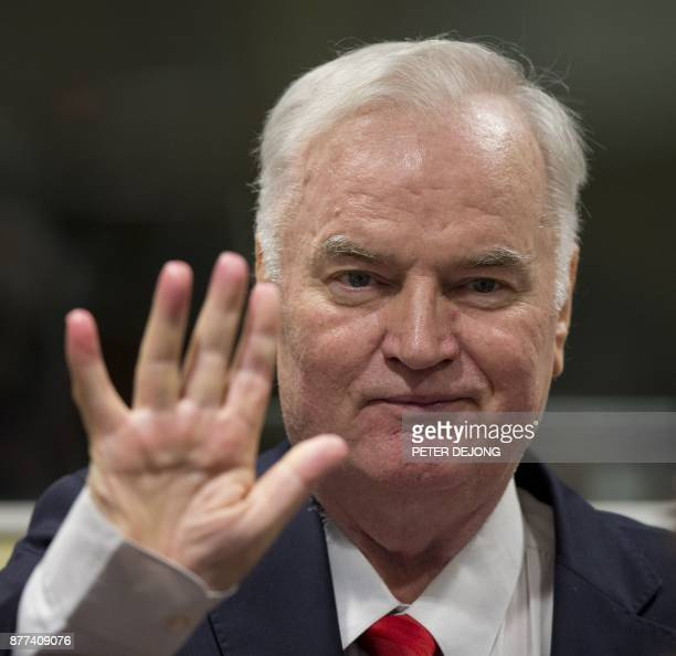 Former Bosnian Serb commander Ratko Mladic waves as he enters the International Criminal Tribunal for the former Yugoslavia on November 22 to hear...