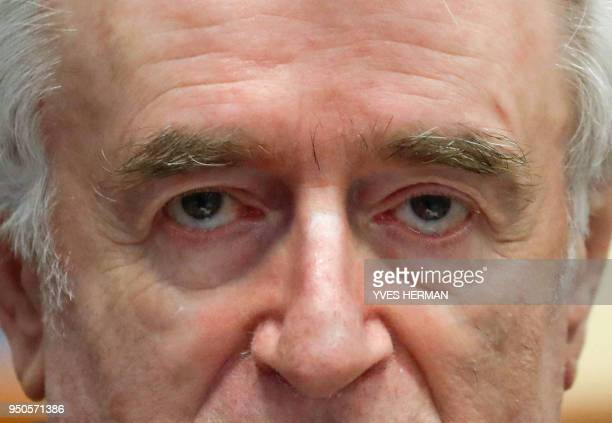 TOPSHOT Former Bosnian Serb leader Radovan Karadzic appears in a courtroom before the International Residual Mechanism for Criminal Tribunals in The...