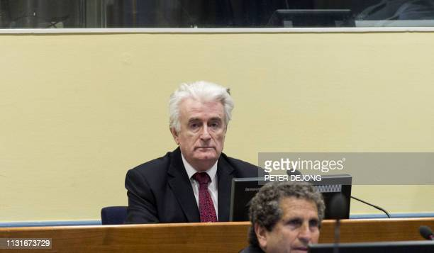 Former Bosnian Serb leader Radovan Karadzic sits in the court room of the International Residual Mechanism for Criminal Tribunals in The Hague...